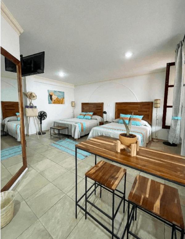 Room 6 – Two Queen beds – 12/21